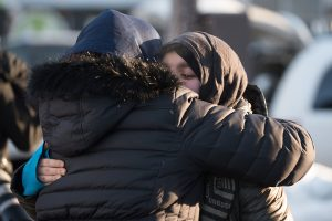 Mourners walk out after a funeral service for three of the victims of the deadly shooting at the Quebec Islamic Cultural Centre, at the Congress Centre in Quebec City, Quebec,on February 3, 2017.  / AFP / Alice Chiche        (Photo credit should read ALICE CHICHE/AFP/Getty Images)